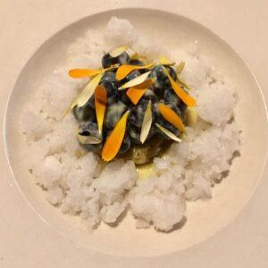 blueberries sunflower cream and marigold on lemon thyme ice